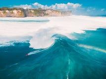Aerial shooting of big wave surfing in Bali. Big waves in ocean Royalty Free Stock Photos