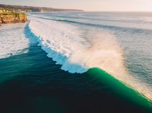 Aerial shooting of big waves at sunset. Biggest ocean waves in Bali Royalty Free Stock Images