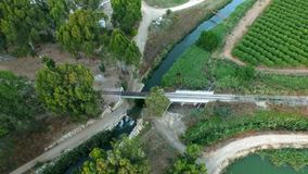 Aerial shooting of the car which passes the small river Royalty Free Stock Photo