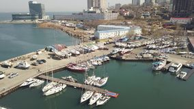 Aerial shooting from drone boat and yacht standing in parking lot in sea port stock video footage