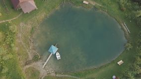Aerial shooting, Look from above at blue mountain lake.  stock video