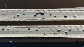 Aerial shooting over the cable-stayed bridge, traffic of cars driving over the water. Aerial shooting over the cable-stayed bridge - the opposite direction of stock footage