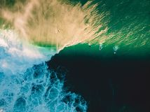 Aerial shooting of surfing at sunset. Surfers and big ocean wave Stock Photo