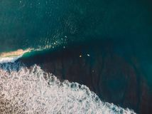 Aerial shooting of surfing. Surfers in tropical ocean Royalty Free Stock Images