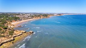 Aerial. Shores of the village Olhos de Agua are shot from sky by drones. Algarve stock image