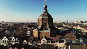 aerial short drone view of old church and birds, cityscape and architecture, historical medieval landscape of europe