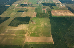 Aerial shot of agriculture fields. And forest Royalty Free Stock Photos