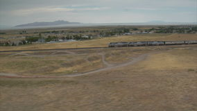 Aerial shot of amtrak train and desert town stock video footage