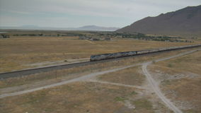 Aerial shot of amtrak train and desert town. Video of aerial shot of amtrak train and desert town stock video footage