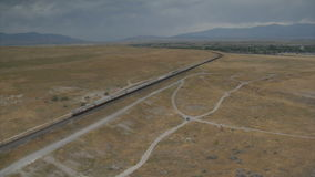 Aerial shot of Amtrak train and desert town stock footage