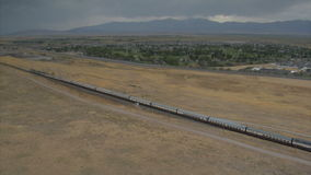 Aerial shot of Amtrak train and desert town. Video of aerial shot of amtrak train and desert town stock footage
