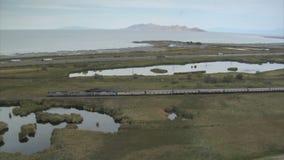 Aerial shot of Amtrak train and Great Salt Lake. Video of aerial shot of amtrak train and great salt lake stock video