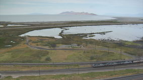 Aerial shot of Amtrak train and Great Salt Lake. Video of aerial shot of amtrak train and great salt lake stock footage
