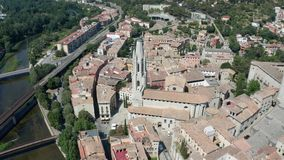 Aerial shot of ancient gothic quarter in Girona. Drone flight over old town with first cathedral in Girona, Basilica of Sant Felui, located in medieval quarter stock video