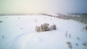 Aerial shot as snow continous to fall. Covering the whole city into snow white stock footage