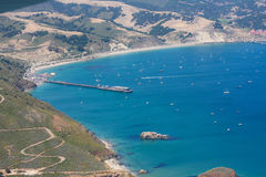 Aerial shot of Avila bay and the California coast. Aerial shot of the beautiful California coastline and historical highway 1.  Avila bay is visible as is the Royalty Free Stock Image