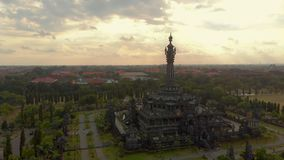Aerial shot of the Bajra Sandhi Monument in the center of Denpasar city on the Bali island, also known as a historical stock video footage