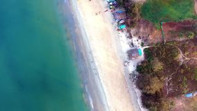 Turquoise watered beach. An aerial shot of the beach`s shore line. The water is turqoise and the sand is white stock footage