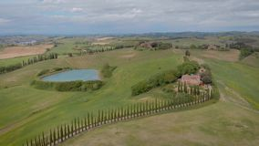 Aerial shot. Beautiful Italian Tuscany. View of small towns or villas.