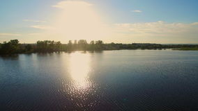 Aerial shot beautiful lake, morning glow, pristine nature stock video