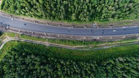 Aerial shot of beauty forest nature landscape with road. royalty free stock photo