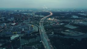 Aerial shot of big city highways intersection. Huge traffic jam near shopping malls in the evening rush hour Royalty Free Stock Image