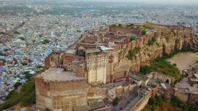 Blue city and Mehrangarh fort on the hill in Jodhpur, Rajasthan, India. Aerial shot.Blue city and Mehrangarh fort on the hill in Jodhpur, Rajasthan, India stock video