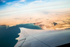 Airplane journey. Aerial shot of blue heaven with white cloud near to South Africa Stock Photo
