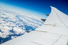 Airplane journey. Aerial shot of blue heaven with white cloud near to South Africa Royalty Free Stock Photo