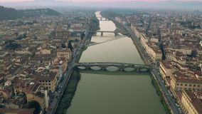 Aerial shot of bridges and the Arno river in Florence in the evening, Italy. Aerial shot of bridges and the Arno river in Florence in the evening stock video