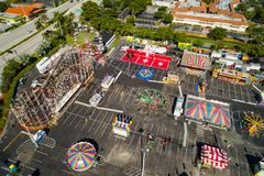 Aerial shot of the Broward County Fair carnival roller coaster. Drone image Broward County Fair at Gulfstream Park parking lot Florida USA Stock Photo