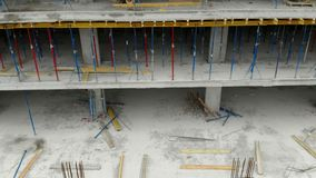 Aerial shot of the building in the process of construction. Workers prepare a platform for pouring cement on the roof. Aerial shot of the building in the stock video