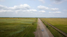 Aerial shot of car on the rural road stock video footage