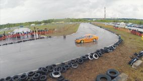 Aerial shot of cars drifting during drift competition named. Clip. Car race aerial view. Racing track and drifting cars.  stock video footage