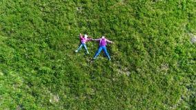 Aerial shot of children at green grass stock video