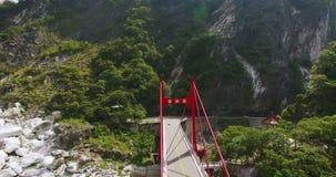 Aerial shot of Cimu Bridge and Shrine stock footage