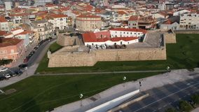 Aerial shot of city of Povoa de Varzim, Portugal with old Napoleonic fort in foreground. Flying slowly back stock video