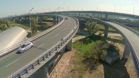 Aerial shot, city road junction with car traffic and train. Stock footage stock video footage