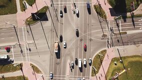 Aerial shot of city road traffic over big crossroad. stock footage