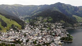 City under alps scenary. Aerial shot of city under Alps mountain scenary stock video footage