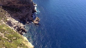 Aerial shot of the cliff line of Mallorca with deep blue water. Video clip