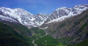 Aerial of big mountain in the Italian alps pull in stock footage
