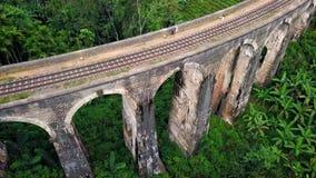 Aerial shot of colonial railway bridge. Viaduct named Nine Arches Bridge. Ella, Sri Lanka stock footage