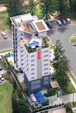 Aerial shot of a condo. Aerial shot of a white condo with a pool on the top floor Royalty Free Stock Photo