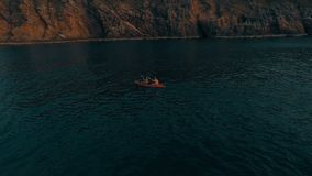 Aerial shot of couple kayaking in the sea during summer day. Travel tropical island holiday concept stock video