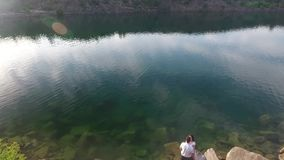 Aerial shot of couple on the lake and hills stock video footage