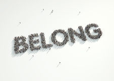 Aerial shot of a crowd of people forming the word 'Belong'. Conc Royalty Free Stock Photo