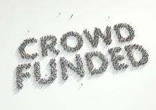 Aerial shot of a crowd of people forming the word 'Crowd Funded'. Concept for crowd funding platforms or projects that are supported financially by crowd royalty free stock images