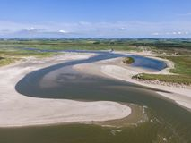 Aerial of the slufter national park with water inlet in the dunes of dutch island Texel. Aerial shot by drone of the slufter national park with water inlet in stock photos