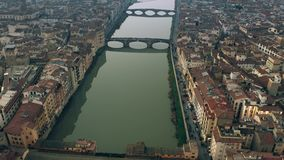 Aerial shot of famous Ponte Vecchio bridge and the Arno river in the evening. Florence, Italy. Aerial shot of famous Ponte Vecchio bridge and the Arno river in stock video